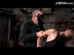 Brunette Girl In Stockings Spanked Getting Tied Up Engulfing Cock In The Dungeon