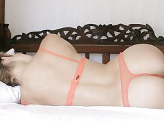 blond beauty with perfect ass relaxing on the bed