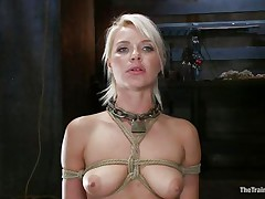beautiful blonde hanging tied up is drilled