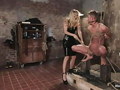 blond domina inducing pain to her sex slave