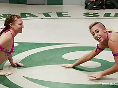 lesbo chicks fighting in the wrestling arena