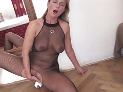 mature blonde masturbating on the floor with a fake penis