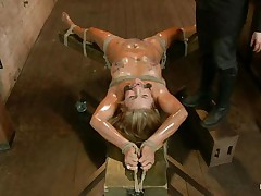 Blonde slut Cameron is all tied up with strings to a wooden table and face hole gagged. With her legs spread, that babe gets fingered and has a sex tool on her clitoris. Let`s take a close look at that hot oiled up body and with wax all over her! Will her goddess make that wench cum if her cunt gets fisted so hard?