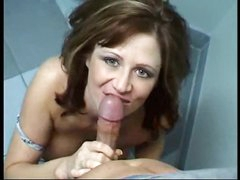 She goes into bathroom to suck cock