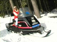 Coldresistant babe undresses on snowmobile