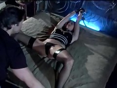 Bondage and sex in a rubber corset and nylons